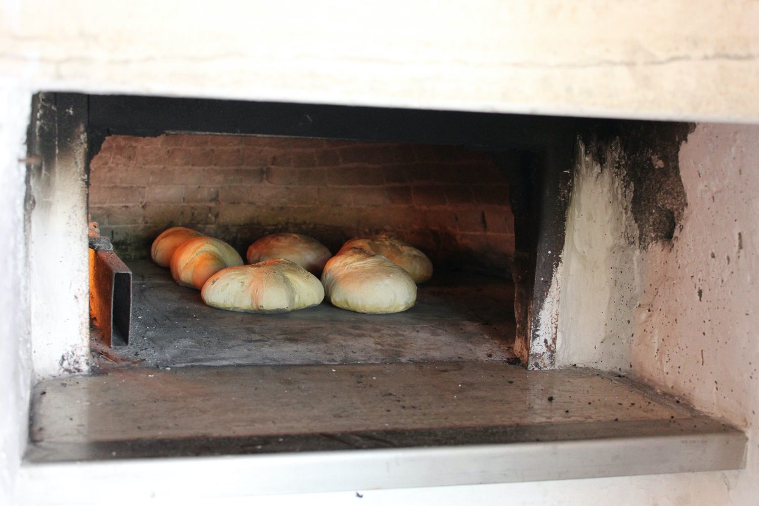 Bread cooking in wood hoven